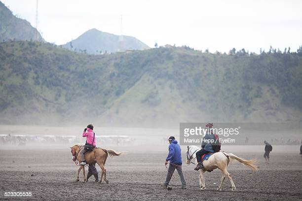People Riding Horses In Field