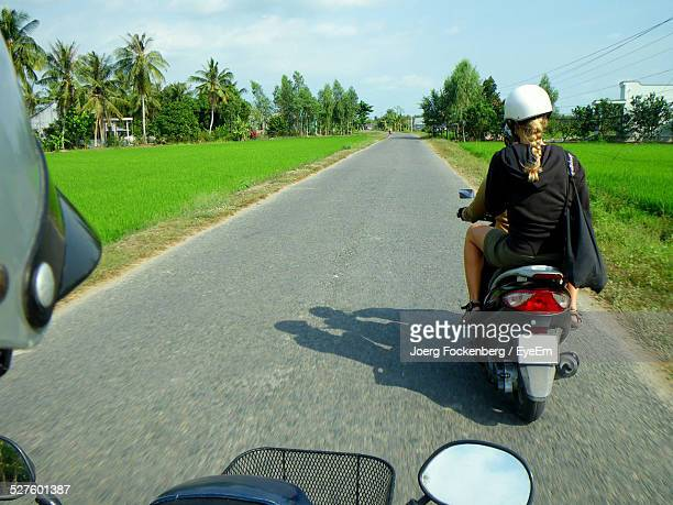 People Riding Motor Scooters