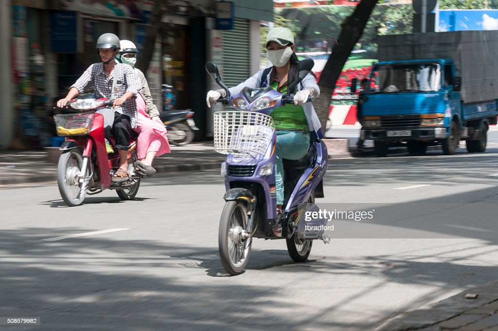 People Riding Scooters In Ho Chi Minh City, Vietnam : Stockfoto