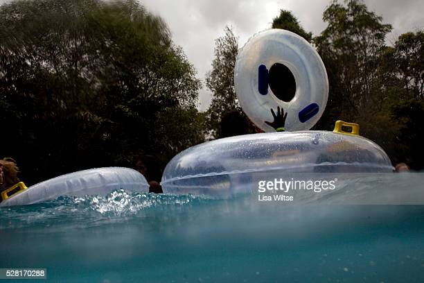 People riding the inner tubes on the lazy river at the Wet n' Wild theme park at Surfer's Paradise on the Gold Coast Austrlia January 23 2009 Photo...