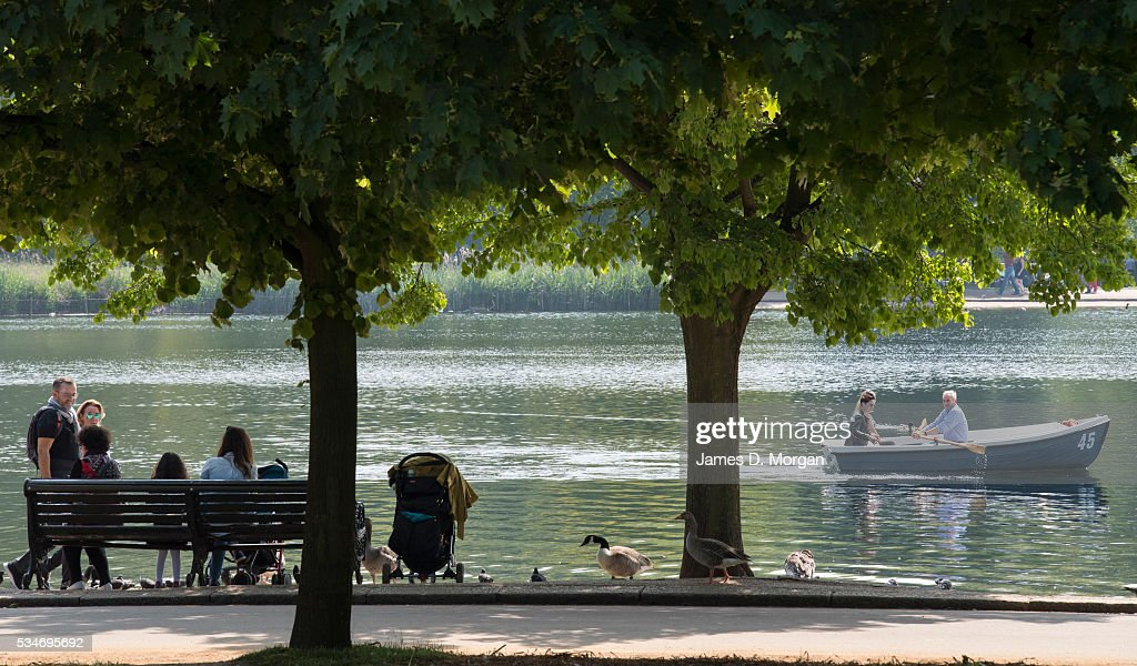 People row a boat in Hyde Park at the Serpentine lake ahead of the Bank Holiday weekend on May 27, 2016 in London, England. The weather today in London was warm and sunny with high temperatures expected to continue for the weekend.