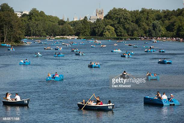 People row boats on the Serpentine lake in Hyde Park on August 22 2015 in London England Weather in the capital is expected to reach 30 degrees today...