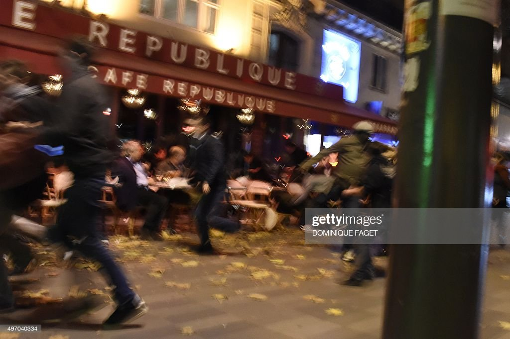 People run after hearing what is believed to be explosions or gun shots near Place de la Republique square in Paris on November 13 2015 At least 18...