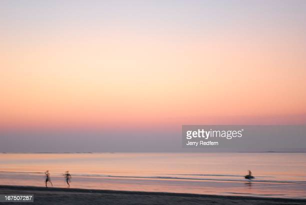 People run along Chaungtha Beach at sunset The Indian Ocean getaway is popular with people from the capital Yangon