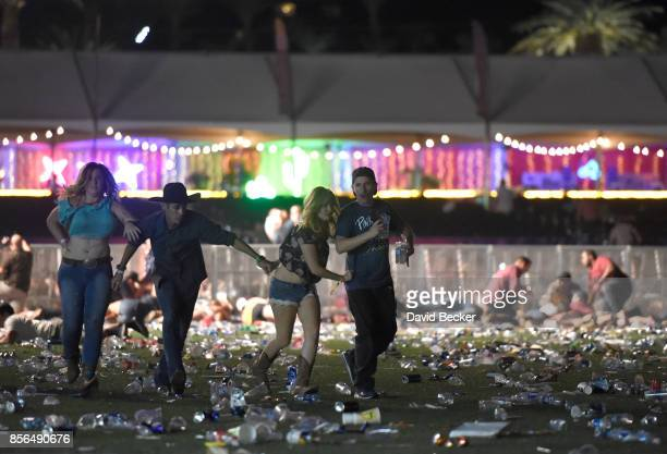 People run from the Route 91 Harvest country music festival after apparent gun fire was heard on October 1 2017 in Las Vegas Nevada There are reports...