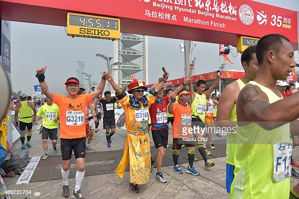 People run towards the finish line during the 2015 Beijing Marathon on September 20 2015 in Beijing China