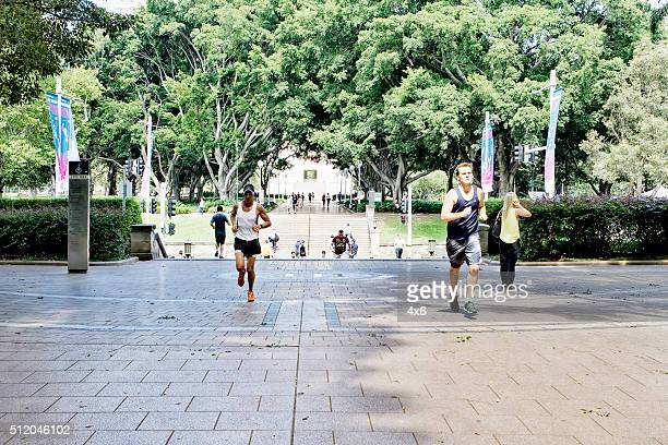 People running in Hyde Park, Sydney