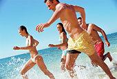 People running in the ocean