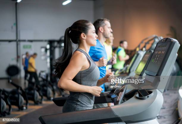 People running in the treadmills at the gym