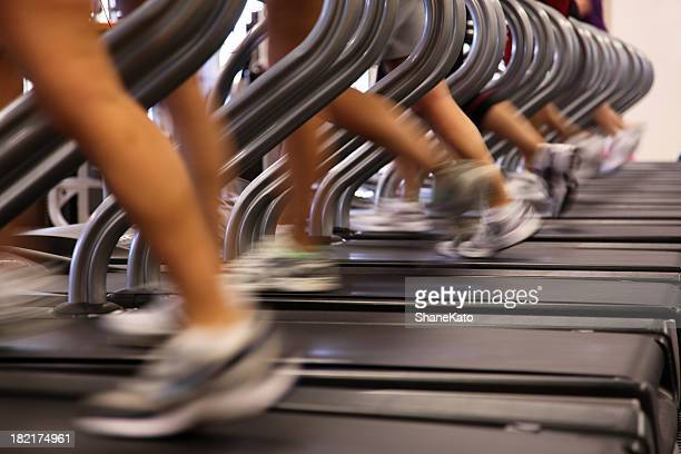 People Running Jogging on Treadmill at Health Club Gym
