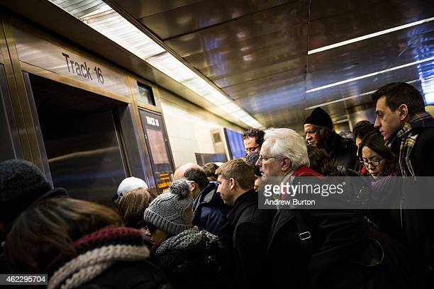 People rush to catch their train at Penn Station while a major snowstorm begins on January 26 2015 in New York City The storm is expected to bring 13...