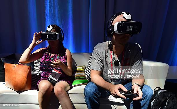 People sample the Oculusmade Samsung Gear VR Virtually Reality headset in Hollywood California on September 24 2015 at the Oculus Connect 2 event AFP...
