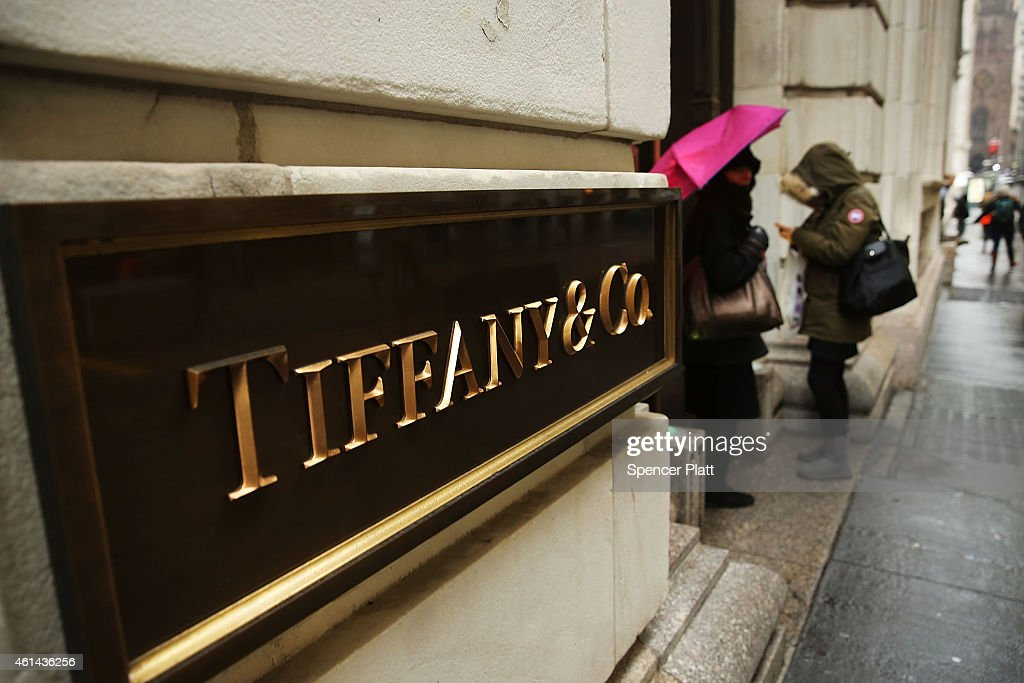 People sans near Tiffany Co store along Wall Street in Manhattan on January 12 2015 in New York City Shares in the luxury jewelry chain fell on news...