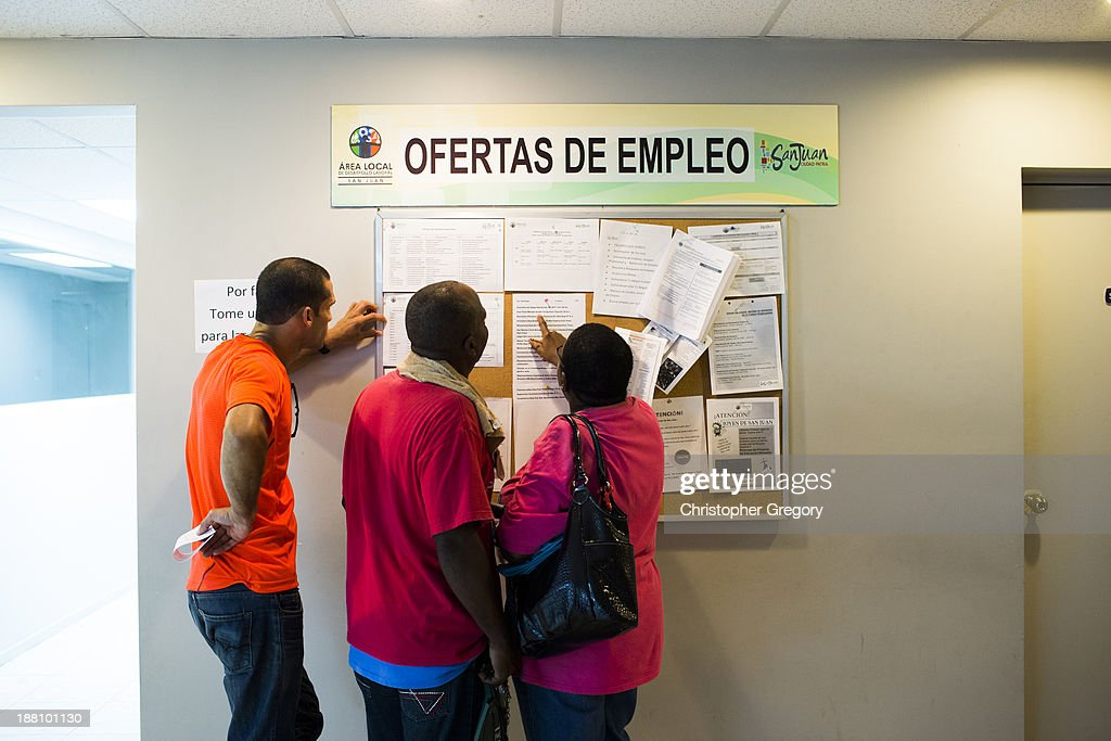 People scan the bulletin board for job postings at the unemployment office on November 14, 2013 in San Juan, Puerto Rico. The unemployment rate hovers around 14 percent, almost twice the national average. The island-territory of the United States is on the brink of a debt crisis as lending has skyrocketed in the last decade with the government issuing municipal bonds. Market analysts have rated those bonds as junk and suspect it's 70 billion dollar debt might be unserviceable in the near future. With a deteriorating manufacturing industry and tourism only contributing to 10 percent of the GDP, the way out is unclear.