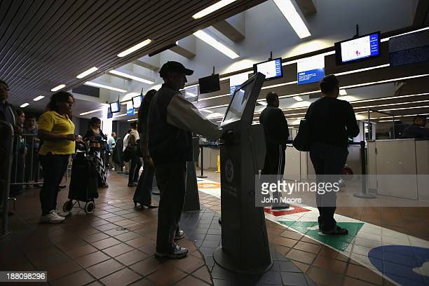 People scan their identifications while crossing from Mexico into the United States at the San Ysidro port of entry on November 14 2013 in San Diego...
