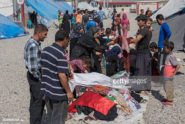 People search for new clothes in the Dibaga camp for Internally Displaced Person after the Iraqi Defense Forces liberated their villages from the...