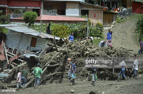 People search for survivors after a landslide in Salgar municipality Antioquia department Colombia on May 18 2015 A massive landslide tore through a...
