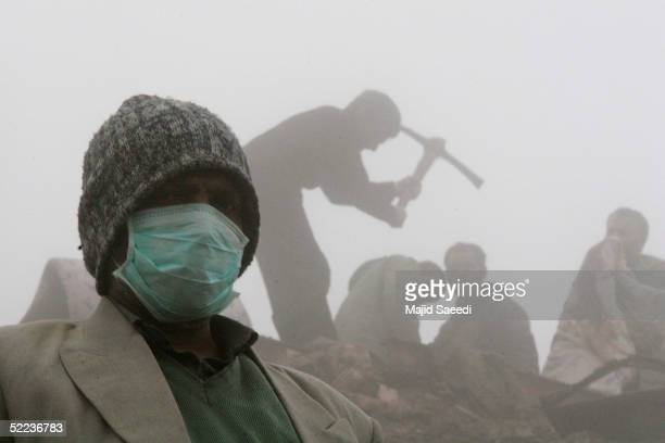 People search for victims of the earthquake February 24 2005 in the village of Dahoueieh about 700 km southeast of the capital Tehran Iran The...