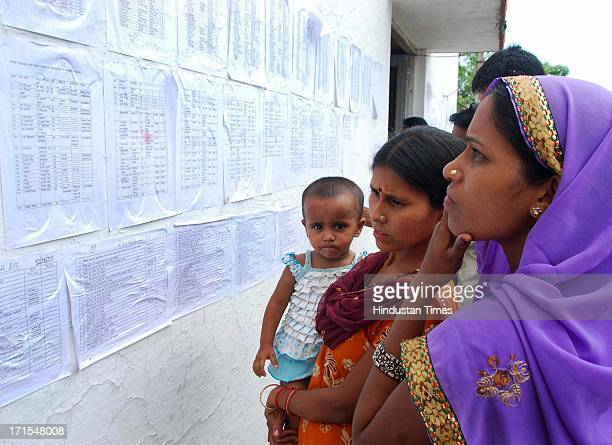 People searching for their relatives names in the list of the dead persons during disaster in Uttarakhand at Police Lines on June 26 2013 in Dehradun...