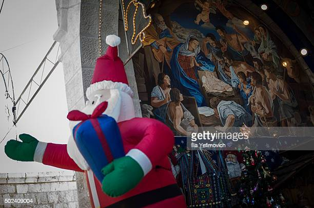 People seen gavering outside the church on nativity on December 24 2015 in Bethlehem West Bank Christians around the world start celebrating the...
