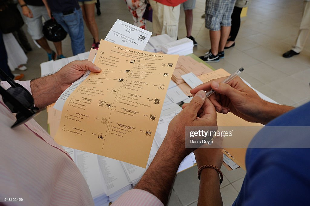 People select party lists for voting in the Spanish general election on June 26, 2016 in Madrid, Spain. Spanish voters head back to the polls on June 26 after the last election in December failed to produce a government. Latest opinion polls suggest the Unidos Podemos left-wing alliance could make enough gains to come in second behind the caretaker government of the center-right Popular Party.