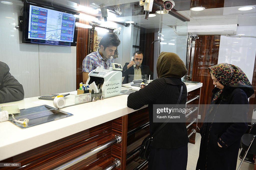 People sell their foreign currencies in an official exchange house when the market prices dropped after an agreement in Geneva of 5+1 group on November 25, 2013 in Tajrish square north Tehran, Iran.