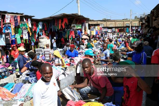 People sell their second hand clothes at Gikomba market in Nairobi Kenya on April 3 2017 Kenyan government's exhortation on buying new clothes...