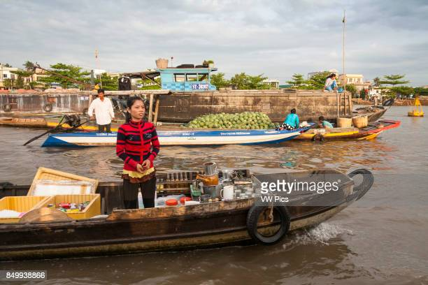 People selling produce from boats in the floating market Cai Rang near Can Tho Mekong River Delta Vietnam
