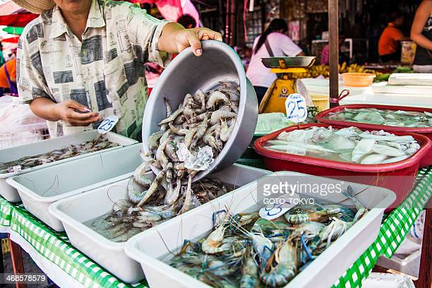 People selling raw Shrimp at the central market