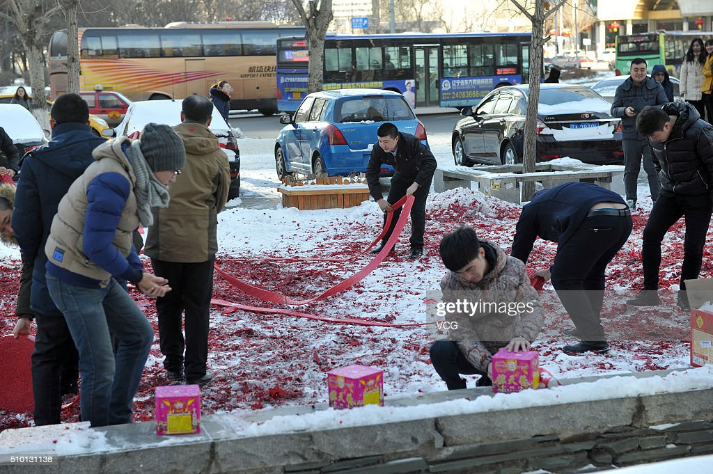 People set off firecrackers on February 14, 2016 in Shenyang, Liaoning Province of China. Chinese businessmen set off firecrackers for good luck on the first working day after the lunar new year.