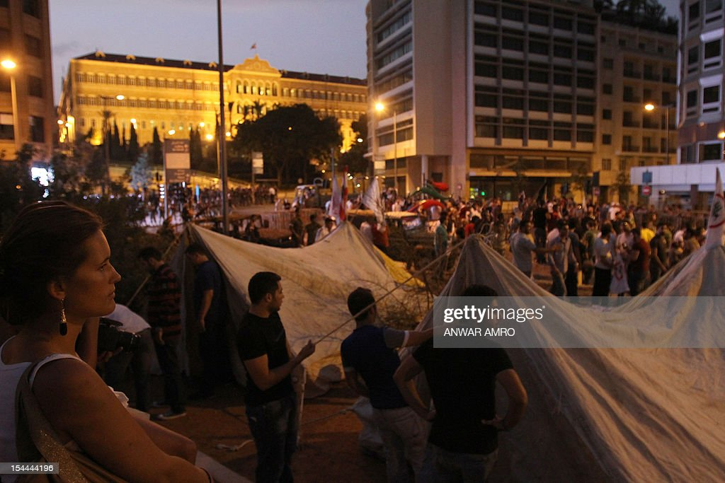 People set up tents and gather outside the Lebanese Grand Serail also known as the Government Palace, the headquarters of the Prime Minister of Lebanon, in downtown Beirut, on October 20, 2012, a day after the assassination of Internal Security Forces (ISF) intelligence chief General Wissam al-Hassan. Lebanon was reeling the day after Hassan was killed in a bombing that was blamed on Syria and also raised fears the country is being sucked into the war ravaging its neighbour. AFP PHOTO /ANWAR AMRO