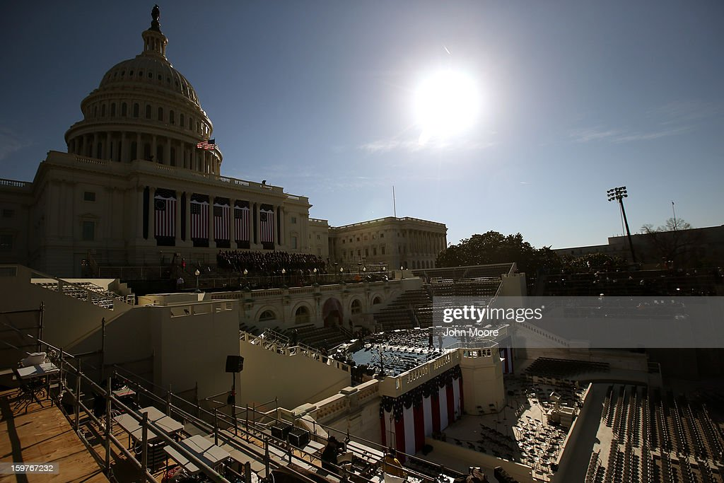 People set up the stage at the U.S. Capitol building as Washington prepares for U.S. President Barack Obama's second inauguration on January 20, 2013 in Washington, DC. Both Obama and U.S. Vice President Joe Biden will be officially sworn in today with a public ceremony for the President taking place on January 21.