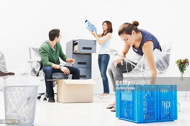 People setting up new office