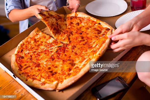 People sharing takeaway pizza
