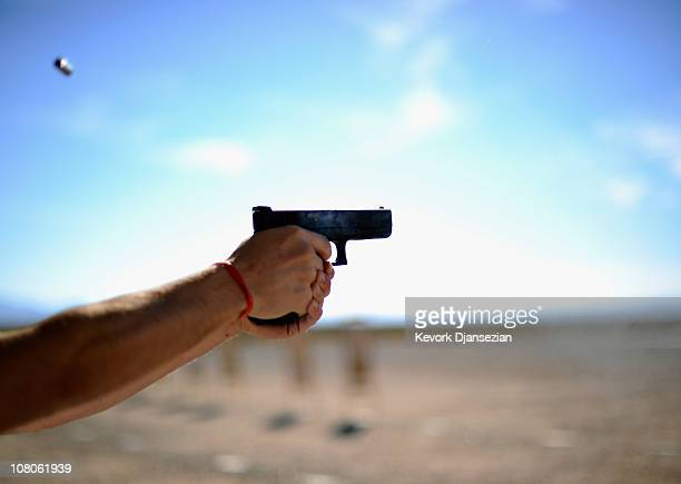 People shoot their guns at the Southwest Regional Park shooting range near the Crossroads of the West Gun Show at the Pima County Fairgrounds on...