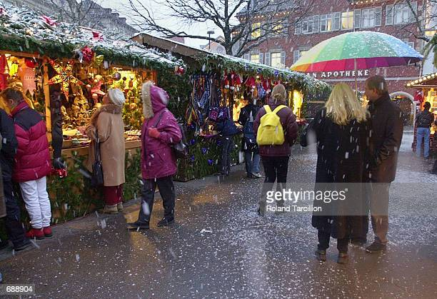 People shop at a Christmas Market December 23 2001 near Stuttgart Germany Thousands flock to the Christmas markets at this time of year to shop and...