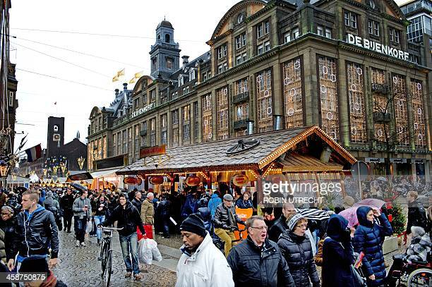 People shop at a Christmas market in the centre of Amsterdam during the last weekend before Christmas in the Netherlands on December 21 2013...