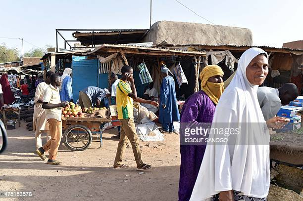 People shop at a market of the central Niger city of Agadez on May 29 2015 AFP PHOTO / ISSOUF SANOGO