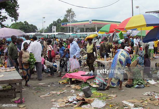 People shop at a small district market in Brazzaville on October 24 ahead of tomorrow's controversial referendum allowing the longtime Congolese...