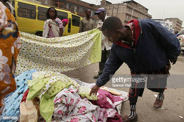 People shop at a street market in Eastleigh a predominantly Muslim Somali neighborhood on August 18 2009 in Nairobi Kenya Referred to locally as...