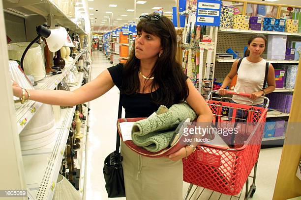People shop at a Target department store July 27 2001 in MiamiDade County FL Consumers are being lured by backtoschool sales and a special statewide...