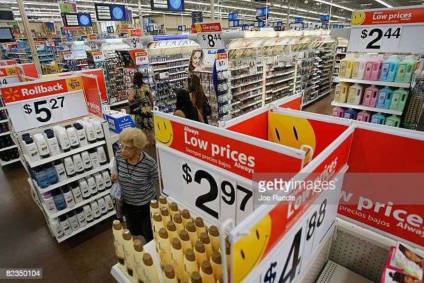 People shop at a WalMart Store August 14 2008 in North Miami Florida The company reported its secondquarter profit rose 17% and it raised its...