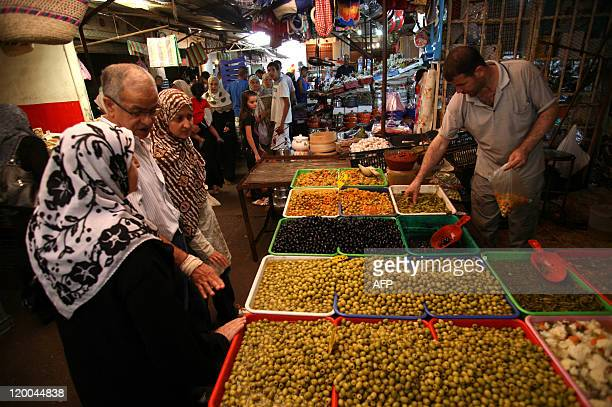 People shop at Ali Mellah market in Algiers on July 27 2011 Faced with crumbling regimes across the Arab world Algeria has dramatically boosted its...