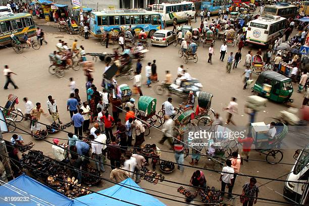 People shop at an afternoon market on July 19 2008 in Dhaka Bangladesh According to a recent World Bank study Bangladesh is among at least 33...