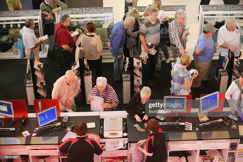 People shop at an Australia Post store at the World Stamp Expo on May 10, 2013 in Melbourne, Australia. The World Stamp Expo is the largest exhibition of its kind in Australia and the second largest ever held in the world.
