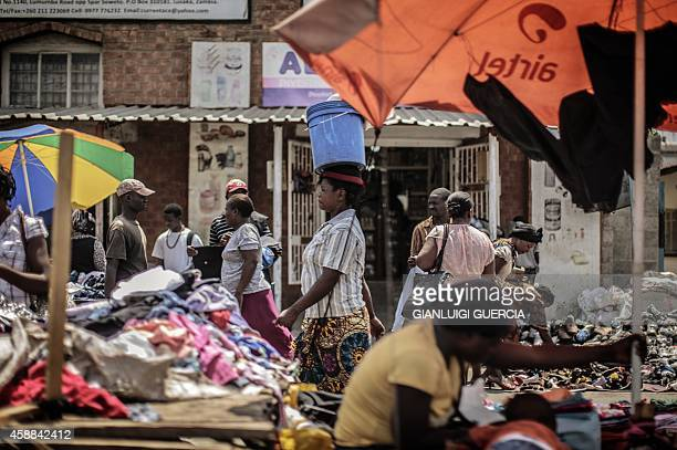 People shop at an open air market on Patrice Lumumba road in Lusaka on November 12 a day after the burial of the late Zambian president AFP...