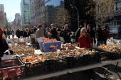 People shop at an outdoor market at Union Square on March 1 2010 in New York City New Yorkers got a respite from the snow and cold today as...