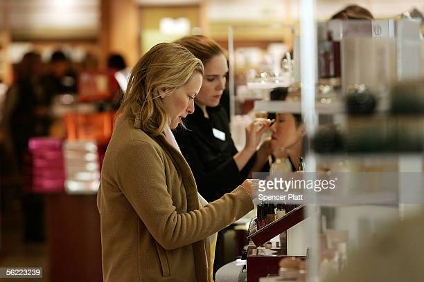 People shop at Macys department store November 18 2005 in New York City US Commerce Secretary Carlos M Gutierrez toured the store Friday meeting with...