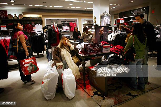People shop at Macy's on November 28 2008 in New York City The day after Thanksgiving often referred to as 'Black Friday' is being looked at this...