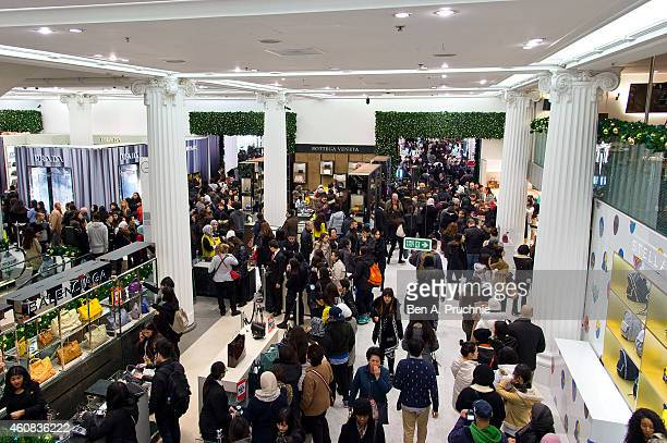 People shop at Selfridges during their Boxing Day Sale on December 26 2014 in London England